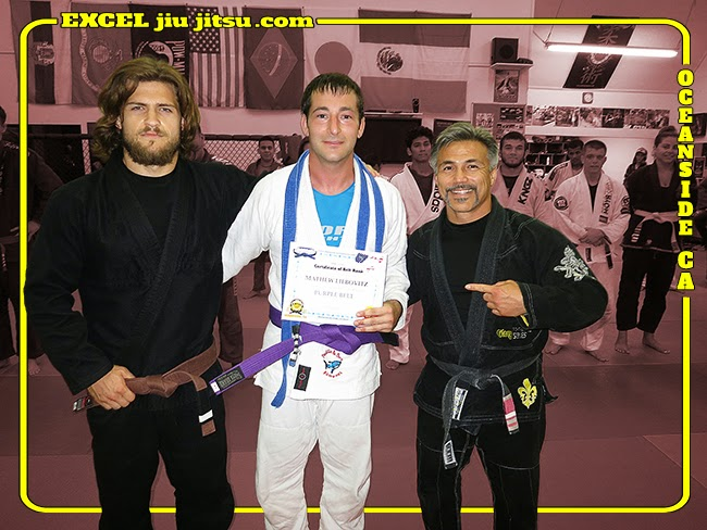 BJJ Coaches Conor Drury and Michio Grubbs with Brazilian Jiu Jitsu Purple Belt Mat Liebovitz