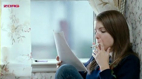 Anna Kendrick smoking a cigarette (or weed)