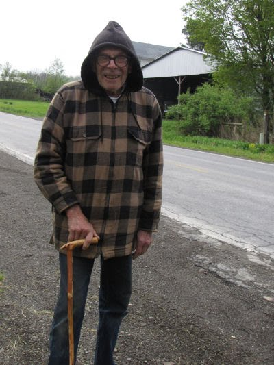 old man with hiking stick