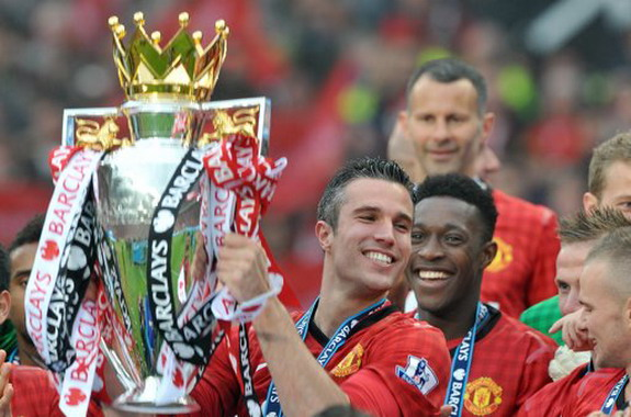 Manchester United striker Robin van Persie poses with the Premier League trophy