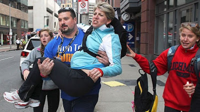 The Superbowl champion offensive lineman Joe Andruzzi comes to the aid of a stricken runner