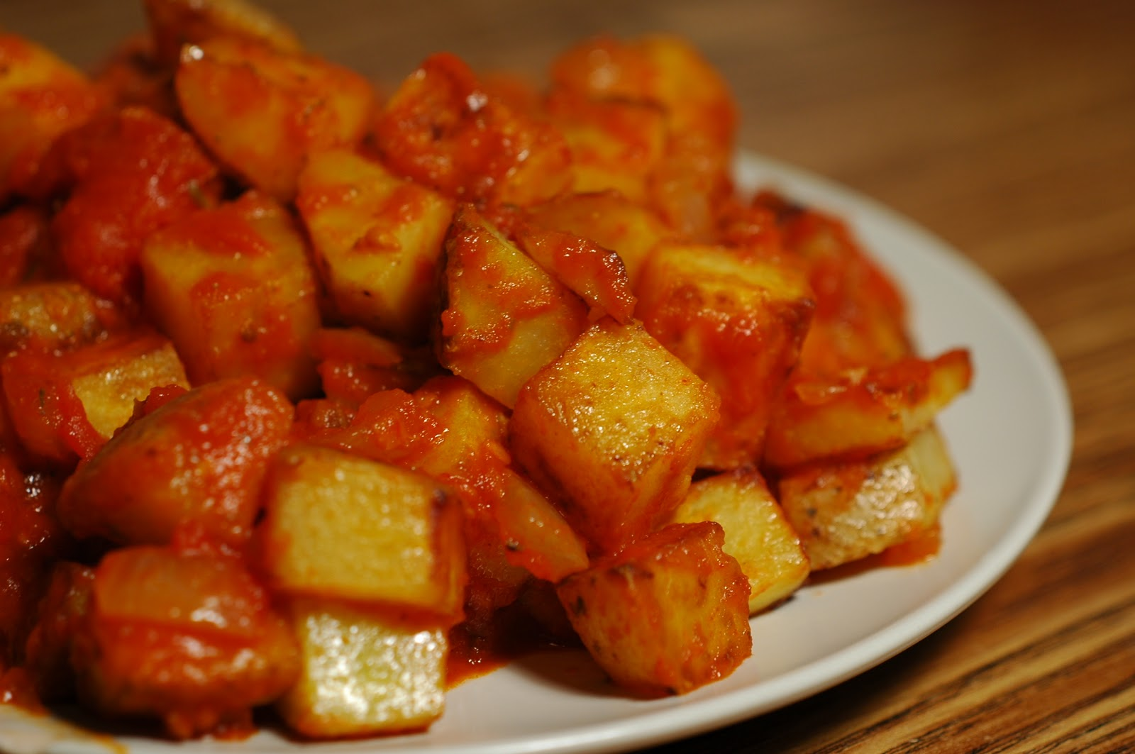 Dinner: Patatas Bravas with corn on the cob and an almond and black ...