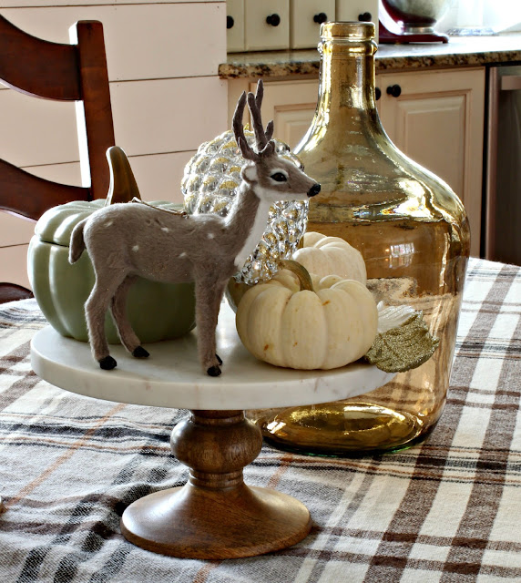 Deer and pumpkins as fall centerpiece in dining room - www.goldenboysandme.com