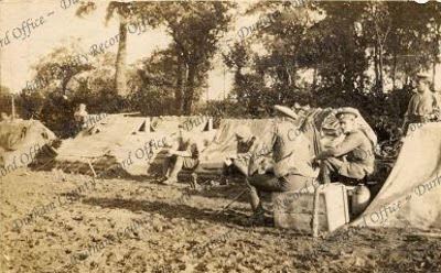 An officer of the 7th Battalion, The Durham Light Infantry, relaxing at a camp in the Western Front, c.1914 - 1918 (D/DLI 2/7/18(183))