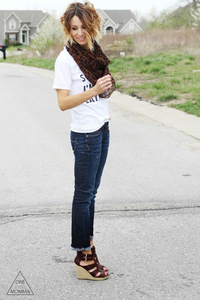 White graphic tee, leopard scarf, dark denim and wedge sandals