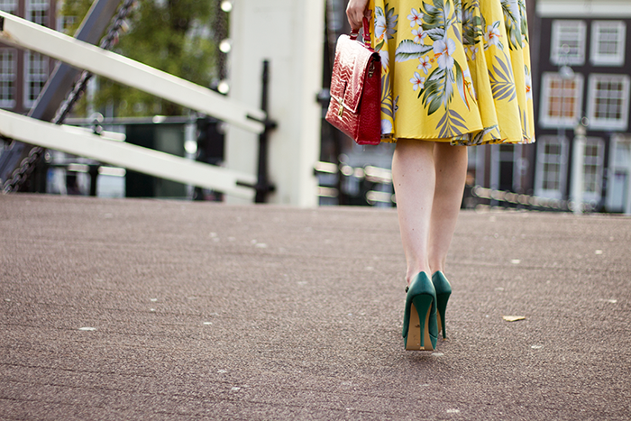 Outfit detail shot midi skirt green heels red bag