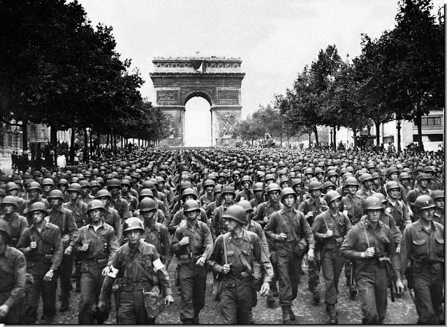 American soldiers march  Paris. August 24 1944