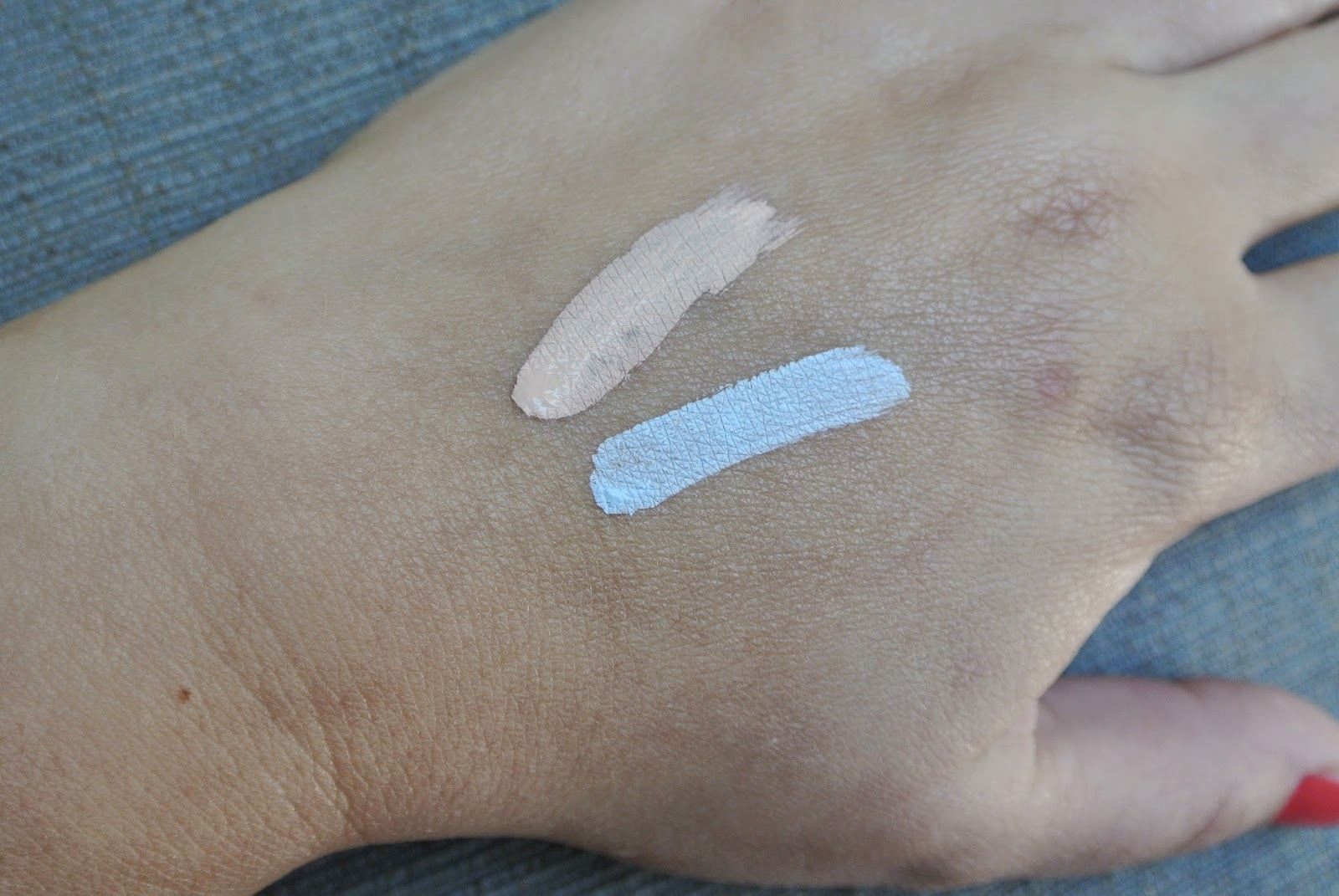 Hand swatches of Laura Mercier Eye Basics in Linen (top) and Eyebright (bottom)