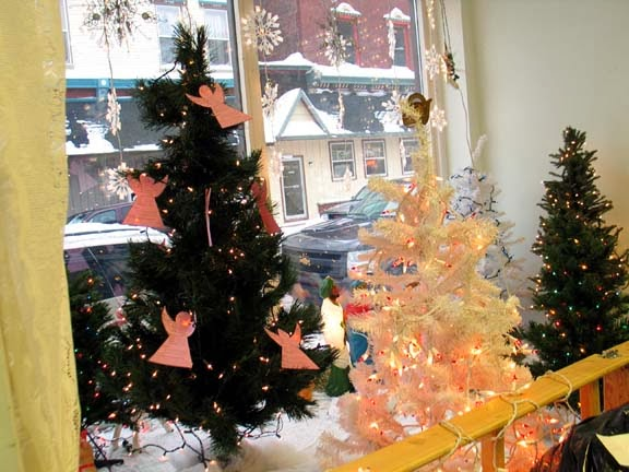 the angel tree in the display window of the new beginnings angel mission free store at 119 fifth street in calumet offers the public an opportunity to - Free Christmas Trees For Low Income Families