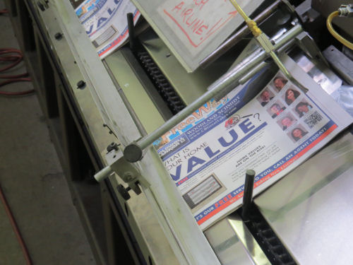 newspaper on a stuffing machine