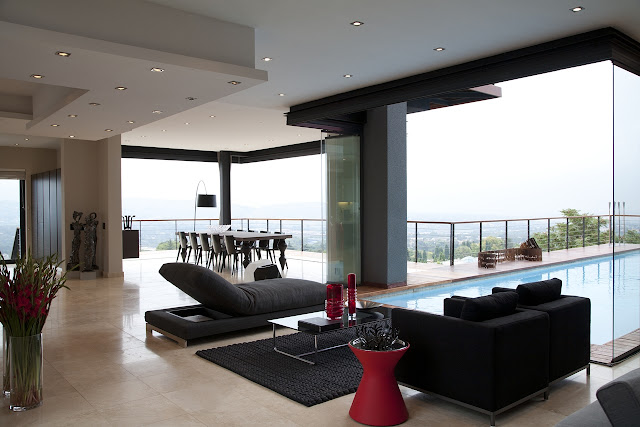 Picture of black sofas in the living room by the swimming pool
