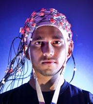 man with brain cap