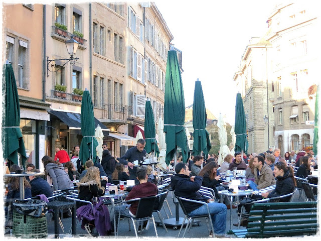 Outdoor cafés aren't just for summer – on the Place de Bourg de Four, Geneva, Switzerland.