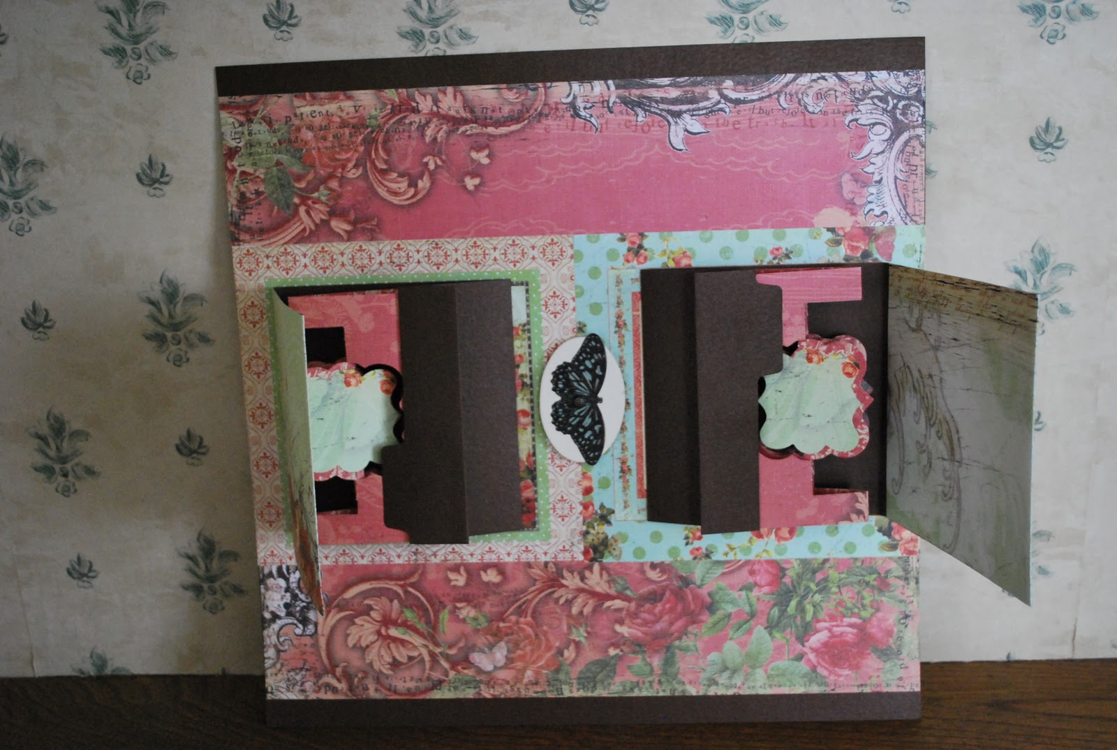 I just recently took a class on pop up scrapbook pages we did a double page layout using the sizzix pop up dies designed by karen burniston she also