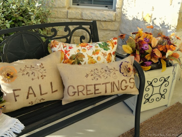 Beautiful fall porch with burlap pillows and beautiful fall decor    Our Home Away from Home