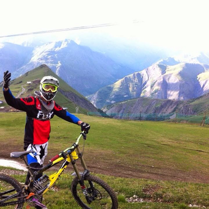 Frederik Leth on his bike in front of beautiful mountains