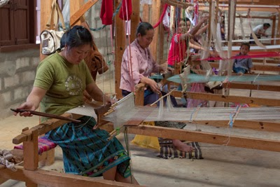 Lao weavers enjoy the community of weaving together in what is usually a solo activity, performed at home.