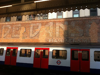 Ghost sign for the Palais De Danse, Hammersmith tube station, London