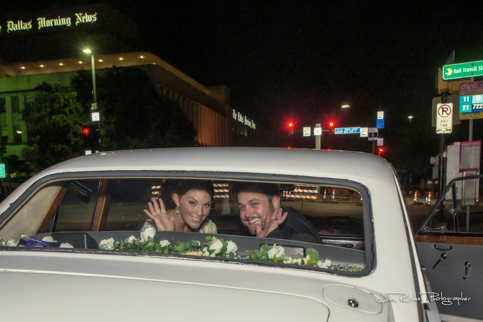 The couple waves goodnight from the back window of their limo.