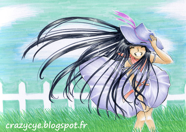Fille souriante dans un pré avec de longs cheveux noirs au vent
