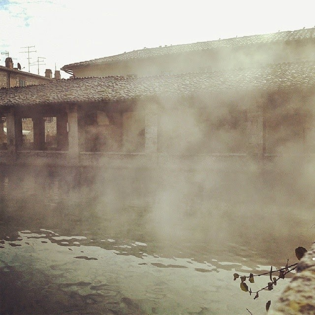 The vapor of the hot springs from the pool in the town square