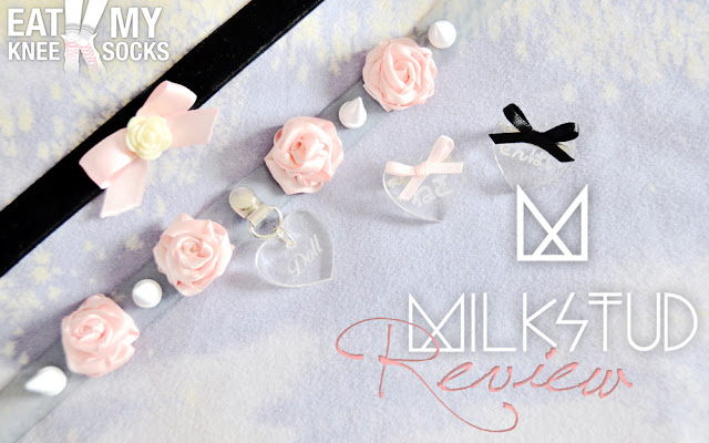 A review of a velvet ribbon rose choker, clear vinyl spiked rose babydoll choker, and two heart-shaped engraved pins from Milkstud, brought to you by Eat My Knee Socks/Mimchikimchi.