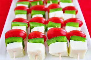 http://www.gimmesomeoven.com/christmas-mini-skewers-tomatoes-peppers-cheese/