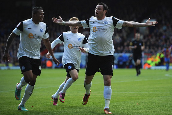 Peterborough player Lee Tomlin celebrates after scoring a goal against Crystal Palace