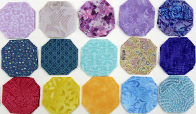 gifted fabrics for my hexie quilt, flower petal sets