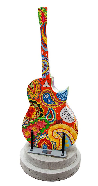 downtown Orillia, painted guitar display, bright colourful paisley design
