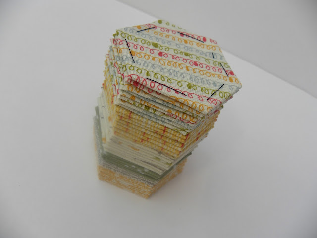 Stack of modern fabric patchwork hexagons