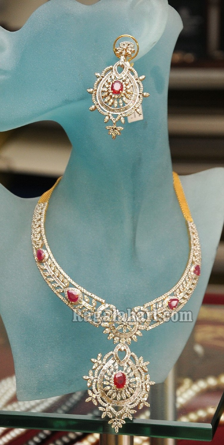 Beautiful 22 Carat Designer Diamond Bridal Necklace Attached With Pendant  And Studded With Round And Oval Ruby's Paired With Heavy Diamond Earrings  By