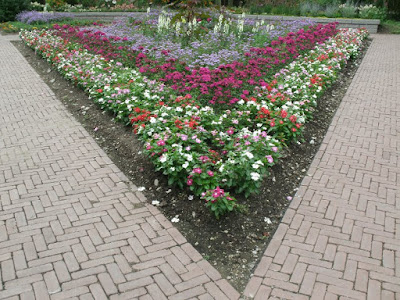 James Garden  triangular annual bed with catharathus by garden muses: a Toronto gardening  blog