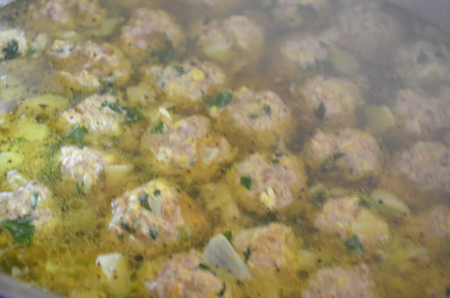 Italian-Wedding-Soup-With-Meatballs-Simmer-In-Broth.jpg