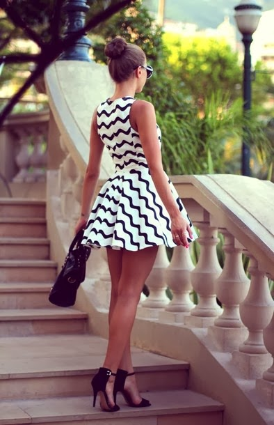 Black line dress, high heels with sunglasses and handbag