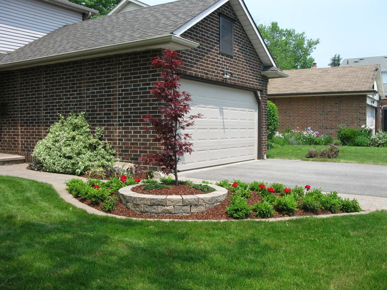 white swan homes and gardens  front yard makeover on jones ave  whitby  ontario