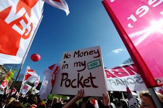 Imagem; EPA; PETER STEFFEN; onda de greves; Ordenados, Aumento Ordenado; Alemanha; Portugal; Conas; Fado; Futebol