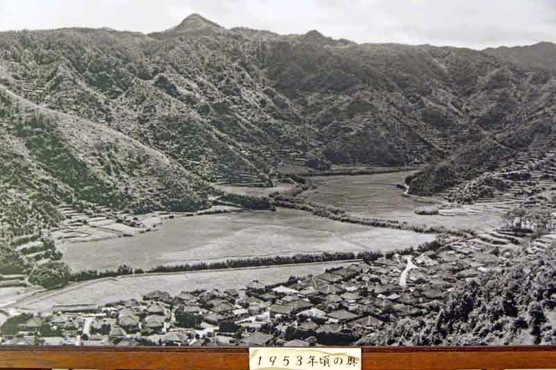 1953 black and white photo of Oku Village,river,mountains