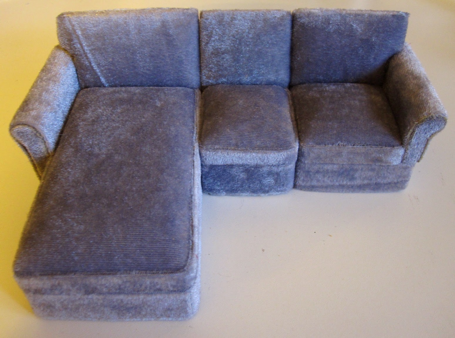 Modern dolls house miniature three piece grey velvet sectional sofa with chaise