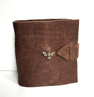 https://www.etsy.com/listing/245409554/brown-leather-mini-journal-with-bee?ref=listing-shop-header-1