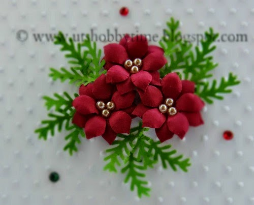 http://www.utshobbytime.blogspot.com/2015/01/handmade-christmas-holiday-greeting-embossed-cas-card-easy-free-poinsettia-punched-paper-flower-tutorial-technique.html