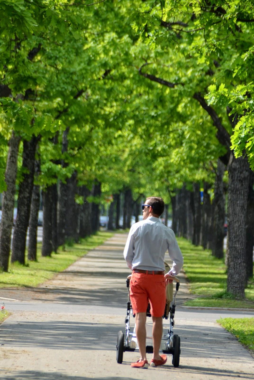 man toddler stroll park