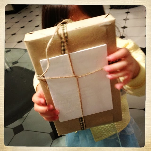 Girl holding up package