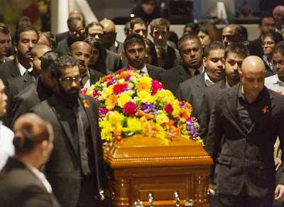 Myuran Sukumaran's coffin enters the service. Photo: James Brickwood