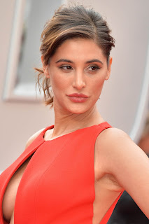 Nargis Fakhri in Gorgeous Deep Neck Orange Sleeveless Gown at Spy UK Premiere At Odeon Leicester Square, London