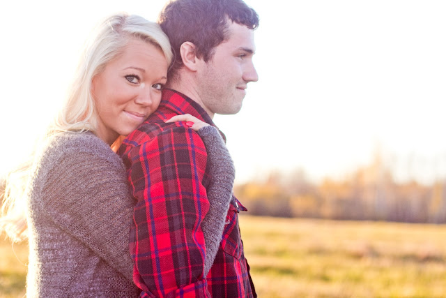 girl wrapping her arms around her boyfriend