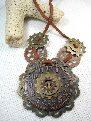 Steampunk style clock and gear necklace on leather