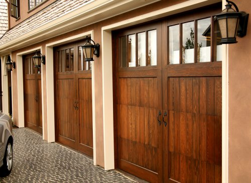 Our french inspired home european style garages and for Rustic wood garage doors