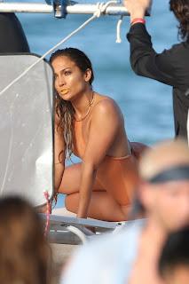 Jennifer Lopez wearing a peach swimsuit