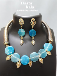 A Beautiful necklace of Blue colour flat round beads